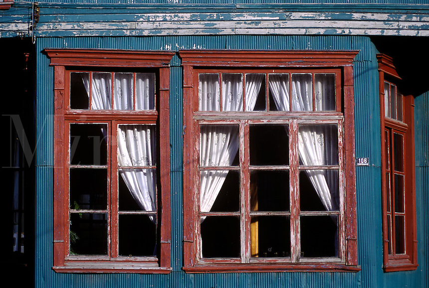 WINDOW & CURTAINS of the historic HOTEL HUILDEN in CHONCHI, a village on CHILOE ISLAND - PATAGONIA, CHILE