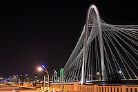 We captured this photo of the Margaret Hunt Bridge over the Trinity River with the Dallas skyline and the pedestrian bridge. This bridge is iconic site in downtown Dallas and architectuarlly beautiul.  It was the second time we have photography this bridge, but the first time the pedestrian bridge park was a road so this was a nice surprise.  This bridge is a unique piece of architecture design that is now part of the dallas skyline.  You can see the Reunion Tower and the Bank of America Plaza in the city skyline in the background.  Also check out our black and white version of this photos.