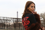 Paris Fashion Week Women AW 2017/2018 - Street Style session in Paris  Isabella Charlotta Poppius - Top: black Kanye West 'Saint Pablo' tour slogan top - Skirt: All Saints black leather a-line zip skirt - Shoes: Common Projects high-top beige suede leather sneakers - Jacket: fur jacket by Yves Salomon - Bag: black Proenza Schouler 'Hava' shoulder bag - Photo Pierre TEYSSOT
