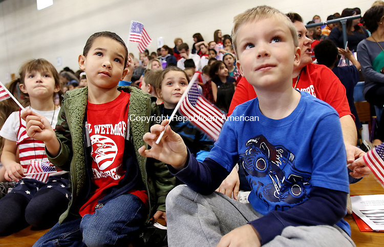 TORRINGTON CT. 14 November 2016-110816SV01-From left, Devon Teti, 6, and Dearrin Royer, 6, first graders, wave their American flags for veterans during the annual Veterans Day celebration event at Vogel-Wetmore School in Torrington Monday.<br /> Steven Valenti Republican-American