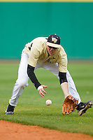 Second baseman Mark Rhine #2 of the Wake Forest Demon Deacons tracks down a ground ball against the LSU Tigers at Alex Box Stadium on February 20, 2011 in Baton Rouge, Louisiana.  The Tigers defeated the Demon Deacons 9-1.  Photo by Brian Westerholt / Four Seam Images