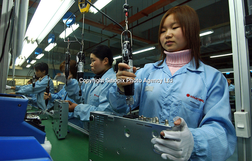 Production line worker at the Solectron factory producing cable TV decoder boxes in Shenzhen, China. Soletron produces decoders for many comapanies including Sky digital..24 Feb 2005