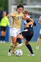 27 August 2011:  FIU's Kelly Ann Hutchinson (12) battles Akron's Ashley Hughes (7) for the ball as the FIU Golden Panthers defeated the University of Arkon Zips, 1-0, at University Park Stadium in Miami, Florida.