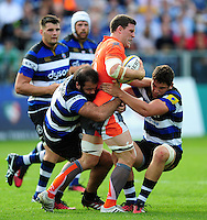 Mark Wilson of Newcastle Falcons is double-tackled by Kane Palma-Newport and Charlie Ewels of Bath Rugby. Aviva Premiership match, between Bath Rugby and Newcastle Falcons on September 10, 2016 at the Recreation Ground in Bath, England. Photo by: Patrick Khachfe / Onside Images