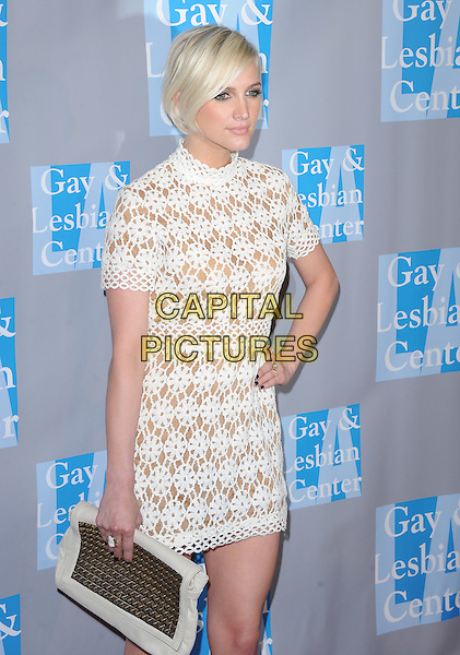 Ashlee Simpson .attends the An Evening With Women held at The Beverly Hilton in Beverly Hills, California, USA, May 19th,2012..half length white crochet dress  high neck   clutch bag hand on hip  tattoo .CAP/RKE/DVS.©DVS/RockinExposures/Capital Pictures.