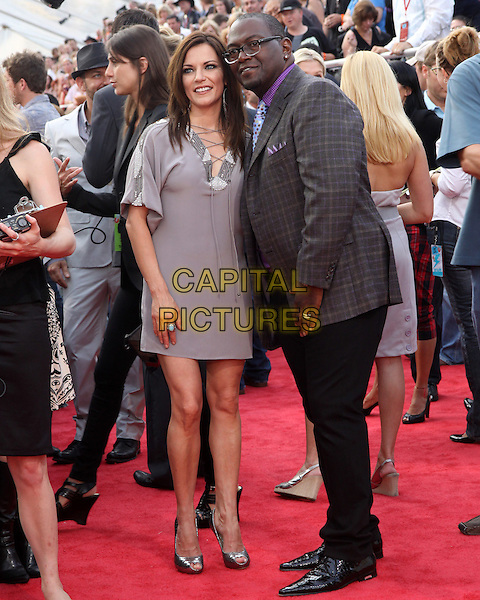MARTINA McBRIDE & RANDY JACKSON.2009 CMT Music Awards held at the Sommet Center, Nashville, TN, USA..June 16th, 2009.full length black trousers grey gray suit jacket purple shirt kaftan dress .CAP/ADM/DH.©Dan Harr/AdMedia/Capital Pictures.