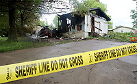 NWA Democrat-Gazette/DAVID GOTTSCHALK   Emergency personnel including the Washington County Sheriff's Office fire marshal inspect Wednesday, May 3, 2017, a home at 1410 Bryan Drive that a fire broke out at 2:02 a.m. Wednesday that was destroyed in Lincoln. Five people were home when the fire broke out. A 16-year-old boy got out of the home and returned to try to save a pet according to Jay Norton, fire administrator. The boy was seriously hurt with burns to his hands, arms and airway,