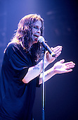 Black Sabbath - vocalist Ozzy Osbourne - performing live at the first reunion concert of the original line-up at the NEC Arena in Birmingham UK - 04 Dec 1997.  Photo credit: George Chin/IconicPix