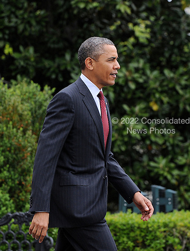 President Barack Obama walks across the South Lawn as he departs the White House May 5, 2013 in Washington, DC. Obama will deliver the commencement speech at The Ohio State University.<br /> Credit: Olivier Douliery / Pool via CNP