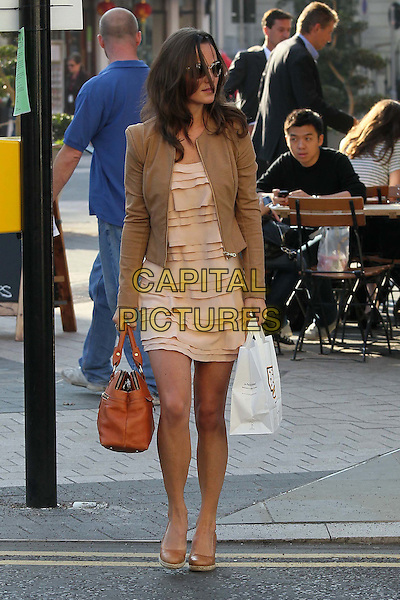 Pippa Middleton on her way to work,.London, England..28th September 2011.full length sunglasses shades pink dress layered layers beige blazer jacket bag purse brown wedges shoes takeaway profile .CAP/HIL.©John Hillcoat/Capital Pictures .
