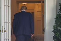 United States President Donald J. Trump walks back to the Oval Office after he held a press conference at the White House in Washington, DC on Tuesday, July 14, 2020.President Trump talks about Democratic presidential candidate Joe Biden, the stock market and relations with China.<br /> Credit: Tasos Katopodis / Pool via CNP/AdMedia