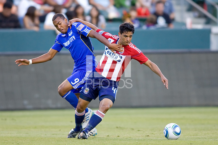 Kansas City Wizards forward Teal Bunbury and Chivas USA defender Michael Umana fight for a loose ball. The Kansas City Wizards defeated CD Chivas USA 2-0 at Home Depot Center stadium in Carson, California on Sunday September 19, 2010.