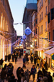 ITALY, Venice. Christmas decorations hangs over Calle Larga XXII Marzo, a street lined with high-end designer shops.