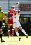 Sarah Sample (17), of Maryland, and Duke's Carolyn Ford (30) challenge for a header on Sunday, October 16th, 2005 at Duke University's Koskinen Stadium in Durham, North Carolina. The Duke University Blue Devils defeated the University of Maryland Terrapins 1-0 during an NCAA Division I Women's Soccer game.