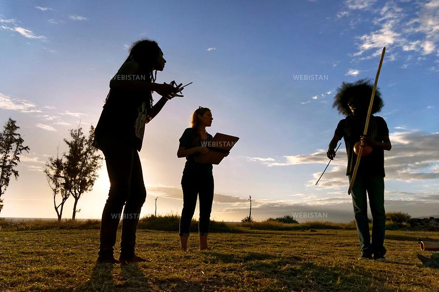 France, Ile de la R&eacute;union, Saint-Leu, La Pointe au Sel <br /> Groupe de musique Saodaj' &agrave; la tomb&eacute;e du jour. Fond&eacute; en 2012, le groupe joue du maloya, l'un des genres musicaux majeurs de la R&eacute;union. H&eacute;ritier des chants des esclaves, il rend hommage aux anc&ecirc;tres, et est class&eacute; au Patrimoine culturel immat&eacute;riel de l'humanit&eacute; de l'UNESCO depuis 2009. Tournage du film &quot;Reza et le futur du monde&quot;, r&eacute;alis&eacute; par Philippe Bonhomme et la soci&eacute;t&eacute; de production On en parle mercredi. Ce film a la vocation de pr&eacute;senter la diversit&eacute; culturelle et religieuse de la R&eacute;union ainsi que son mod&egrave;le du vivre-ensemble, mis en exergue et photographi&eacute; par Reza. // France, Reunion Island, Saint-Leu, La Pointe au Sel. Saodaj' music group at dusk.<br /> Founded in 2012, the group plays Maloya, one of the major musical genres of Reunion. Heir to the songs of the slaves, he pays homage to the ancestors, and is classified as intangible Cultural Heritage of Humanity of UNESCO since 2009. <br /> The film &quot;Reza and the future of the world&quot; is directed by Philippe Bonhomme and produced by the company &quot;On en parle mercredi.&quot; This film focuses on the island's cultural and religious diversity, as well as its way of living together, highlighted and photographed by Reza.<br /> <br /> Distribution HEMIS