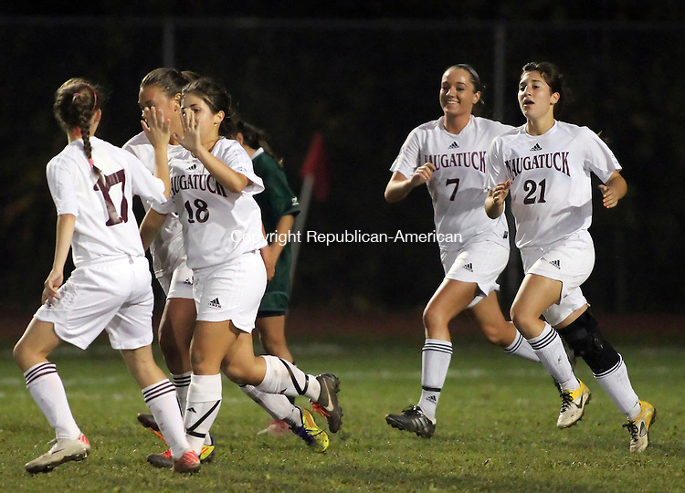 Naugatuck, CT-24 October 2011-102411CM09- Naugatuck's Kattherine Bottinick (18) is congratulated by teammate Kelly Koslosky (17) after scoring Naugatuck's first goal Monday night in Naugatuck. The Greyhounds shut out Holy Cross 3-0.  Christopher Massa Republican-American