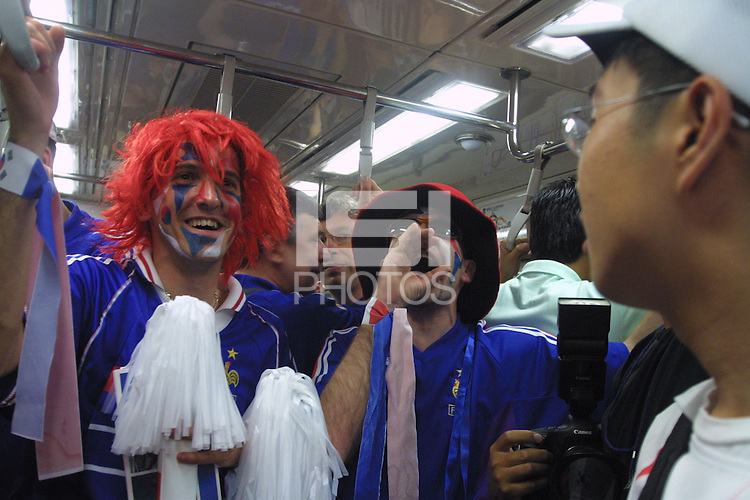 "Frecnch national team supporters, nicknamed ""Les Blues"", chant ""We are the champions, We are the World Champions"" in French while on the subway from the Itaewon district to the Seoul World Cup Stadium before the opening day match between France and Senagal on Friday May 31st, 2002 in Seoul, South Korea."