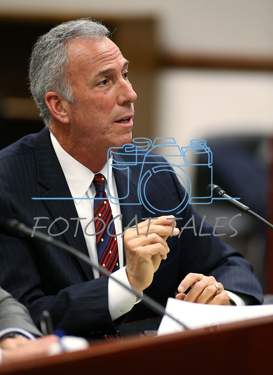 Clark County District Attorney Steve Wolfson testifies in committee at the Legislative Building in Carson City, Nev., on Wednesday, May 6, 2015. Nevada Assistant Attorney General Wes Duncan is at left. <br /> Photo by Cathleen Allison
