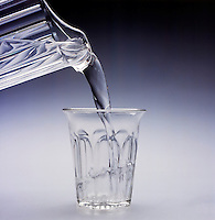 WATER IN ITS LIQUID STATE<br /> (Variations Available)<br /> Poured From a Pitcher Into a Glass. Liquids are fluid because they can flow and change shape.