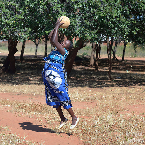 A pregnant woman plays netball at the Mhalaunda Health Centre in Mhalaunda, Malawi. The centre, where women from the surrounding countryside come to safely give birth, is supported by the Maternal, Newborn and Child Health program of the Livingstonia Synod of the Church of Central Africa Presbyterian.