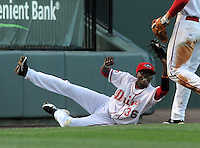 Shortstop Jose Vinicio (36) of the Greenville Drive makes a sliding catch up against the left field wall in a game against the Augusta GreenJackets on April 19, 2012, at Fluor Field at the West End in Greenville, South Carolina. Vinicio is the No. 21 prospect for the Boston Red Sox, according to Baseball America. (Tom Priddy/Four Seam Images)