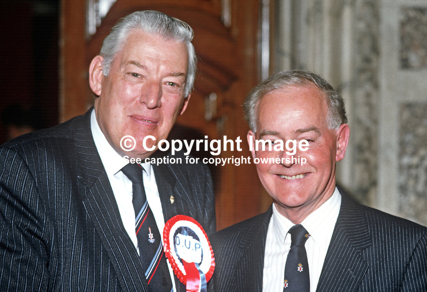 Rev Ian Paisley, MP, MEP, Assemblyman, Democratic Unionist Party, N Ireland, UK, left, with James Molyneaux, leader, Ulster Unionist Party, at the local government election count in the City Hall. 19850509IP2.<br />