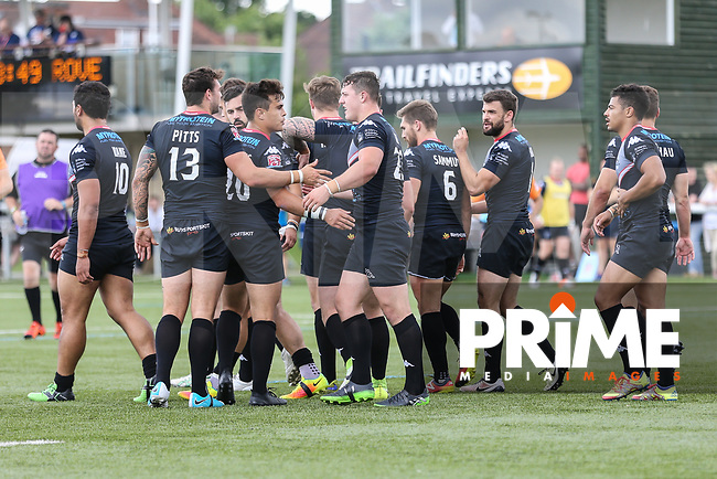 Matt Gee of London Broncos (centre) celebrates with team mates after he scores a try during the Kingstone Press Championship match between London Broncos and Featherstone Rovers at Castle Bar , West Ealing , England  on 25 June 2017. Photo by David Horn.