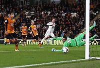 Gylfi Sigurosson of Swansea City hits the post with his shot during the Capital One Cup match between Hull City and Swansea City played at the Kingston Communications Stadium, Hull