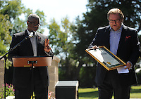STAFF PHOTO ANDY SHUPE - Joseph Wood, Arkansas Deputy Secretary of State, left, speaks alongside the Rev. Steve Dixon, pastor of Christian Life Cathedral, during a dedication ceremony Sunday, Sept. 21, 2014, for the Gehring Cemetery at Christian Life Cathedral in Fayetteville.