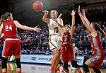 BROOKINGS, SD - FEBRUARY 4:  Kerri Young #10 from South Dakota State passes the ball to a teammate between a trio of defenders from the University of South Dakota during their game Saturday afternoon at Frost Arena in Brookings. (Photo by Dave Eggen/Inertia)