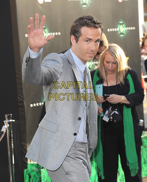 "Ryan Reynolds.World Premiere of ""Green Lantern"" held at Grauman's Chinese Theatre in Hollywood, California, USA..June 15th, 2011             .half length hand palm waving blue shirt tie grey gray jacket .CAP/RKE/DVS.©DVS/RockinExposures/Capital Pictures."