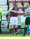 Arbroath's Alan Cook celebrates with Paul Sheerin (11) after he scores their third goal.