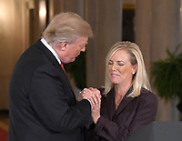 United States President Donald J. Trump, left, shakes hands with Principal Deputy White House Chief of Staff Kirstjen Nielsen, right, after announcing he will name her as Secretary of Homeland Security in the East Room of the White House in Washington, DC on Thursday, October 12, 2017.  If confirmed, Nielsen will replace Acting US Secretary of Homeland Security Elaine C. Duke, who has been in that position since General John F. Kelly, USMC (Retired) resigned to become White House Chief of Staff.<br /> Credit: Ron Sachs / CNP /MediaPunch