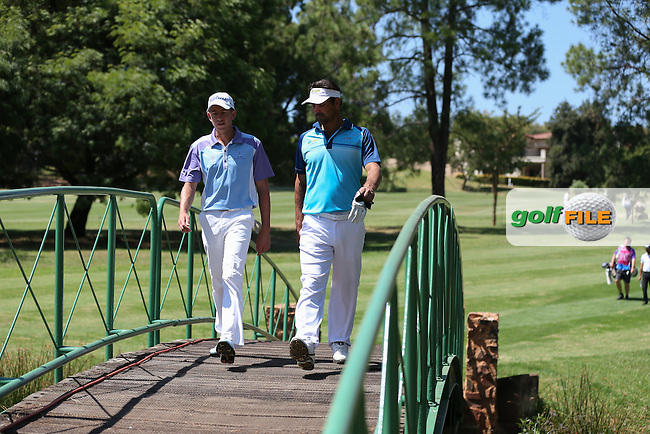 Steven Ferreira (RSA) and Michiel Bothma (RSA) cross the bridge to the 17th during Round Two of the Tshwane Open 2015 at the Pretoria Country Club, Waterkloof, Pretoria, South Africa. Picture:  David Lloyd / www.golffile.ie. 13/03/2015