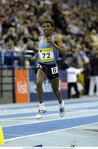 HAILE GEBRSELASSIE (ETH) during the race, Men's 2miles, Norwich Union Grand Prix, National Indoor Arena 030221 Photo:Neil Tingle/Action Plus...Athletics 2003.athlete man distance.run running runners runner runs.track