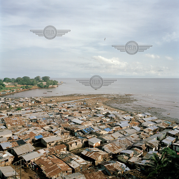 A view of Kroo Bay, a slum built on a rubbish dump on the eastern outskirts of the capital Freetown, which houses around 6,500 people. The rubbish that is washed down the hill from the city toward Kroo Bay is compacted in the bay to the extent that houses can be built on the surface, thus reclaiming land from the sea. ..