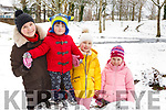 Irina, Mark, Nicole and Sofia Zabarska from Tralee enjoying trying to build a snowman in the Town Park on Friday.