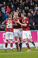 Rod McDonald of Northampton Town (centre) celebrates scoring his team's third goal against Morecambe during the Sky Bet League 2 match between Northampton Town and Morecambe at Sixfields Stadium, Northampton, England on 23 January 2016. Photo by David Horn / PRiME Media Images.