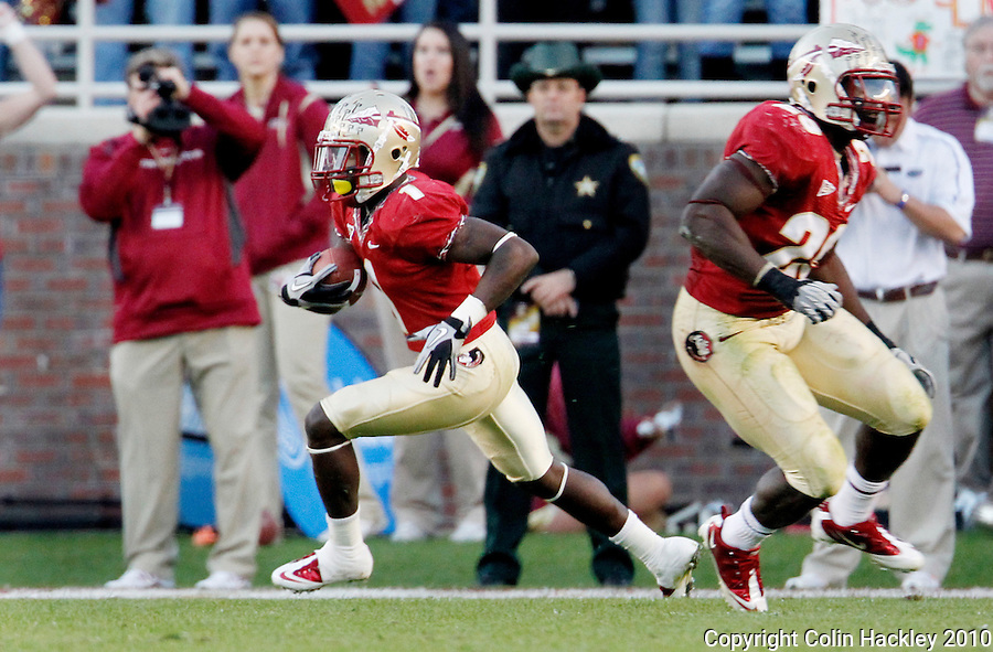 TALLAHASSEE, FL 11/27/10-FSU-UF FB10 CH-Florida State's Mike Harris returns his interception against Florida during first half action Saturday at Doak Campbell Stadium in Tallahassee. .COLIN HACKLEY PHOTO