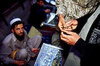 A refugee from Afghanistan is selling used watches at the Kashmiri bazaar man in the old town of Lahore.<br /> 18.2.2001, Lahore/Pakistan<br /> Copyright: Christian-Ditsch.de<br /> [Inhaltsveraendernde Manipulation des Fotos nur nach ausdruecklicher Genehmigung des Fotografen. Vereinbarungen ueber Abtretung von Persoenlichkeitsrechten/Model Release der abgebildeten Person/Personen liegen nicht vor. NO MODEL RELEASE! Nur fuer Redaktionelle Zwecke. Don't publish without copyright Christian-Ditsch.de, Veroeffentlichung nur mit Fotografennennung, sowie gegen Honorar, MwSt. und Beleg. Konto: I N G - D i B a, IBAN DE58500105175400192269, BIC INGDDEFFXXX, Kontakt: post@christian-ditsch.de<br /> Bei der Bearbeitung der Dateiinformationen darf die Urheberkennzeichnung in den EXIF- und  IPTC-Daten nicht entfernt werden, diese sind in digitalen Medien nach §95c UrhG rechtlich geschuetzt. Der Urhebervermerk wird gemaess §13 UrhG verlangt.]