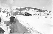 A winter scene at Cumbres with a C-16 headed for the camera.  Taken from west switch toward on coming locomotive.  Depot to right rear.<br /> D&amp;RG  Cumbres, CO  Taken by Lively, Charles R.