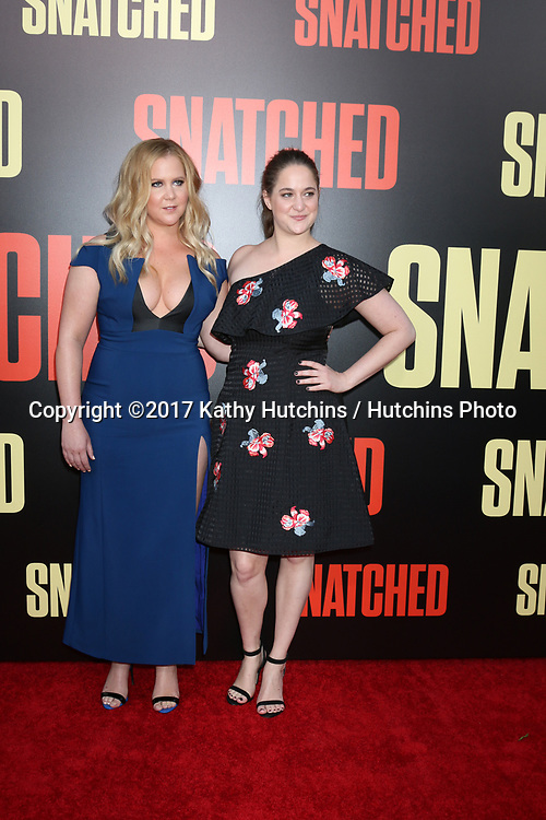 "LOS ANGELES - MAY 10:  Amy Schumer, Kim Caramele at the ""Snatched"" World Premiere at the Village Theater on May 10, 2017 in Westwood, CA"