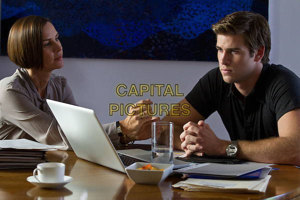 Embeth Davidtz &amp; Liam Hemsworth<br /> in Paranoia (2013) <br /> *Filmstill - Editorial Use Only*<br /> CAP/FB<br /> Image supplied by Capital Pictures