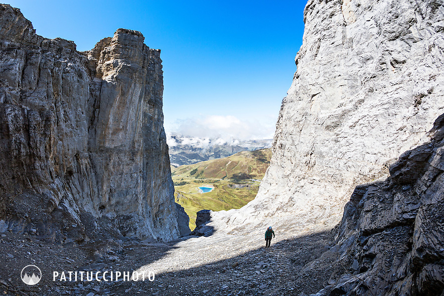 A woman climbing the Eiger Rotstock Via Ferrata, a short, easy climb on the west side of the famous Eiger North Face that leads to the summit of the sub peak, the Rotstock. Grindelwald, Switzerland