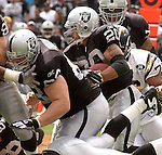 Oakland Raiders defensive tackle Trace Armstrong (93) blocks for full back Justin Fargas (20) on Sunday, September 28, 2003, in Oakland, California. The Raiders defeated the Chargers 34-31 in overtime.