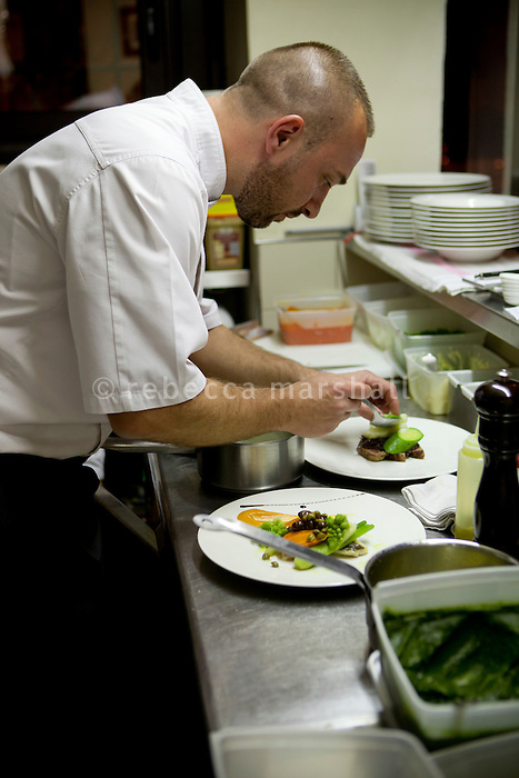 Chef Laurent Parrinello prepares dishes at his restaurant 'L'Armoise'. Antibes, France, 07 April 2012