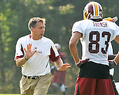 Ashburn, VA - July 20, 2008 -- Head Coach Jim Zorn shows some technique to wide receiver James Thrash (83) during the morning session of the opening day of the 2008 Washington Redskins training camp at Redskins Park in Ashburn Virginia on Sunday, July 20, 2008..Credit: Ron Sachs / CNP