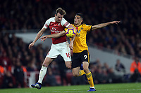 Raul Jimenez of Wolves and Rob Holding of Arsenal during Arsenal vs Wolverhampton Wanderers, Premier League Football at the Emirates Stadium on 11th November 2018