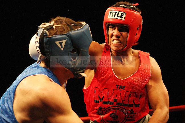 Evan Fisher of Phi Kappa Psi takes a punch from ATO Fredrick Williams during The Main Event hosted by Alpha Delta Pi and Sigma Chi  at the Lexington Convention Center in Lexington, Ky., on Thursday, November 7, 2013. Photo by Michael Reaves | Staff