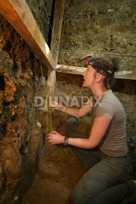"Kira Westaway collects samples for dating in an excavation pit at Liang Bua cave, discovery site of the Flores ""hobbit, Homo floresiensis"